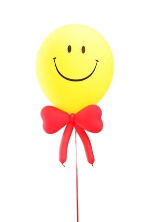 Smiley face baloon with a red bow tie isolated on white background photo