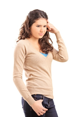 Unhappy female teenager posing isolated on white background photo