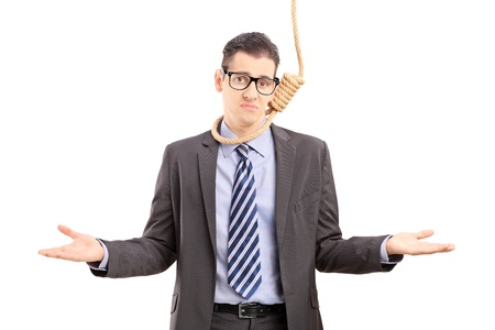 suffocate: Young businessman in suit with a rope around his neck, gesturing isolated on white background