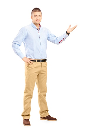 Full length portrait of a young handsome guy gesturing with his hand isolated on white background Stock Photo - 20831004
