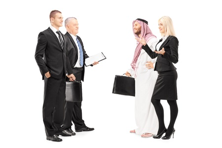 arab people: Full length portrait of businessmen and businesswoman having a conversation during a investment meeting isolated on white background Stock Photo