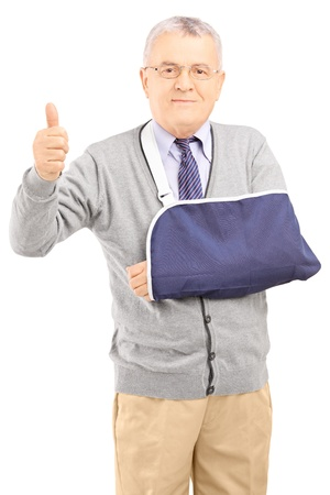 broken arm: Senior man with broken arm giving thumb up isolated on white background