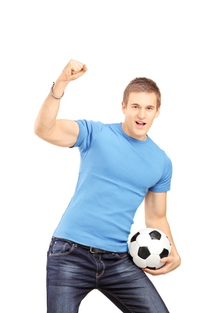 euphoric: Euphoric fan holding a soccer ball and cheering isolated on white background