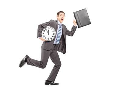 late 20s: Full length portrait of a busy businessperson running late with wall clock and briefcase isolated on white background