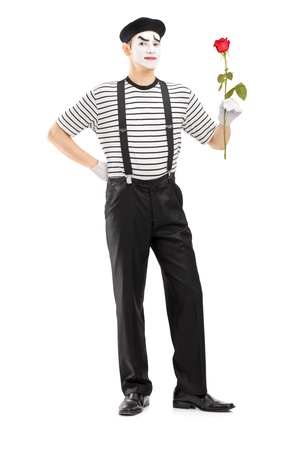 Full length portrait of a male mime artist holding a rose flower isolated on white background photo