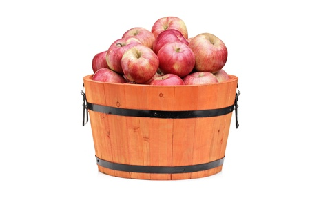 bushel: Studio shot of red apples in a wooden barrel isolated on white background