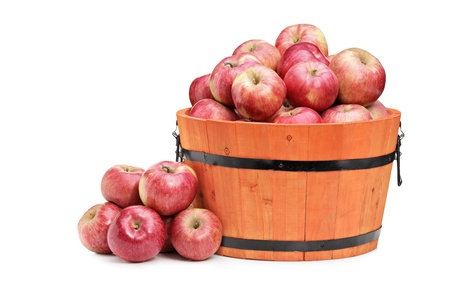 bushel: Studio shot of red apples in a wooden bucket isolated on white background