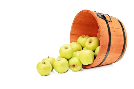 apples basket: Studio shot of yellow apples in a wooden bucket isolated on white background Stock Photo