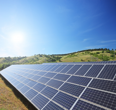 solar equipment: View of a solar photovoltaic cell panels under sunny sky, shot with a tilt and shift lens