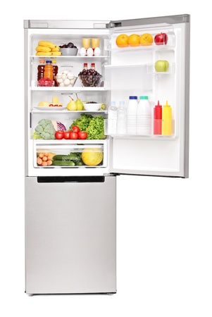 refrigerator: Studio shot of an open fridge full of healthy food products isolated on white background