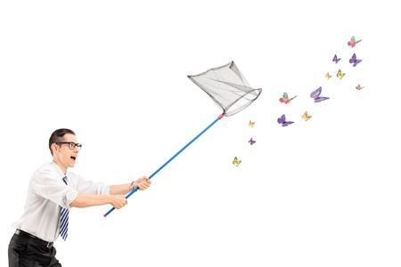 Man catching butterflies with net isolated on white background photo