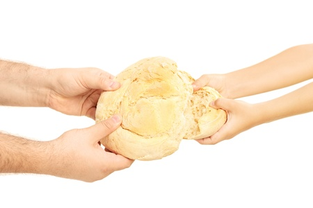 partake: Man and child breaking apart a bread loaf isolated on white background Stock Photo