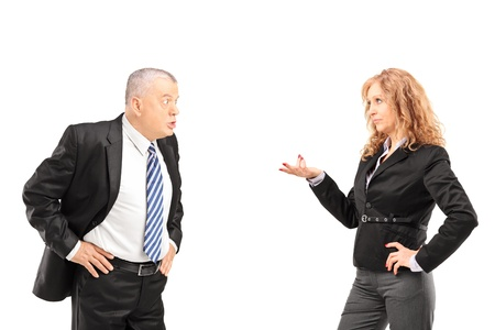 Mature man having a disagreement with a woman isolated on white background photo