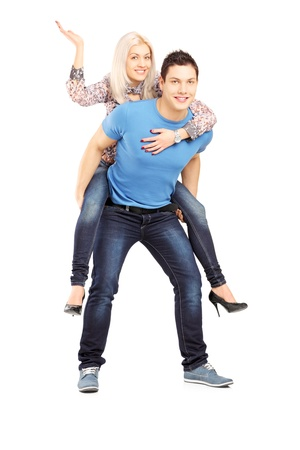 piggy back: Young man giving his girlfriend a piggy back ride, isolated on white background