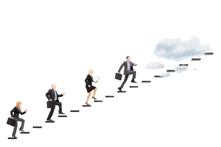 Group of businesspeople walking towards the heights isolated on white background
