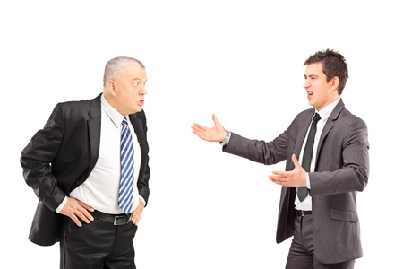 Two angry business colleagues during an argument, isolated on white background photo