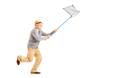 Full length portrait of a mature man running with butterfly net isolated on white background Imagens