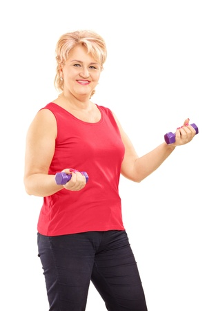 Mature smiling woman lifting up weights isolated on white background photo