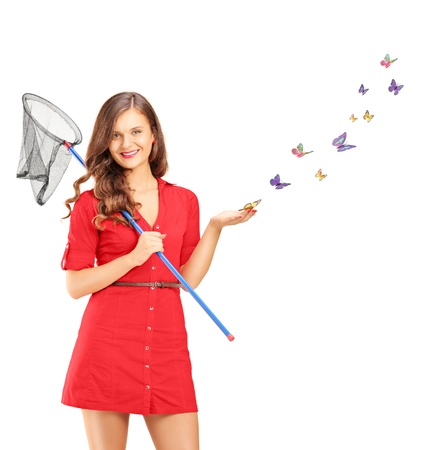 Smiling young female holding a butterfly net and butterflies around her isolated on white background, shot with a tilt and shift lens photo
