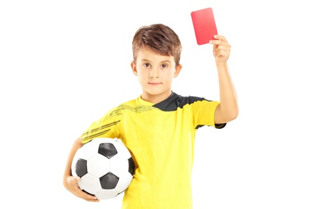 plimsoll: Kid in sportswear holding soccer ball and giving red card isolated on white background
