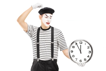 mimic: Mimic holding a clock and thinking, isolated on white background Stock Photo