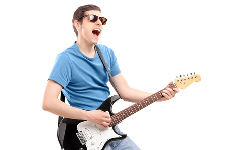 playing music: Guy playing on an electric guitar isolated on white background