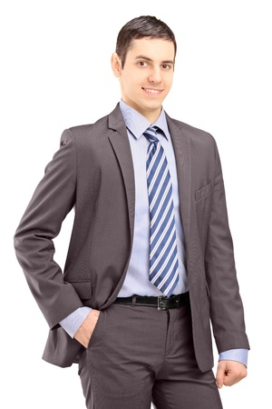 Young businessman wearing grey suit and looking at camera isolated on white background