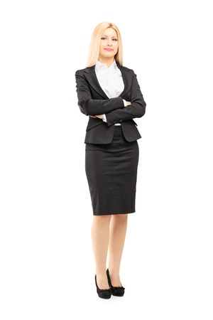 Full length portrait of a blond businesswoman looking at camera isolated against white background photo