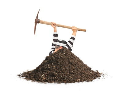 fraudster: Male prisoner digging a hole and trying to escape isolated on white background