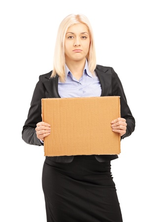 Sad young businesswoman holding a piece of cardboard and looking at camera, isolated on white background photo