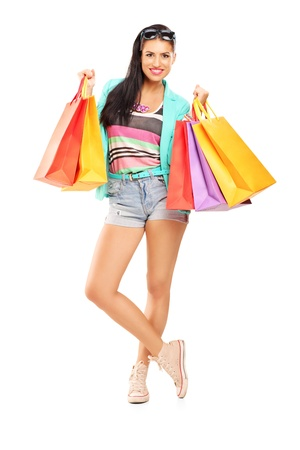 Full length portrait of an attractive casual female posing with shopping bags isolated on white background Stock Photo - 22132881
