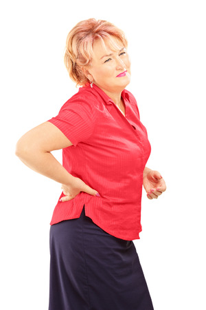 dorsalgia: Mature woman suffering from a back pain isolated on white background