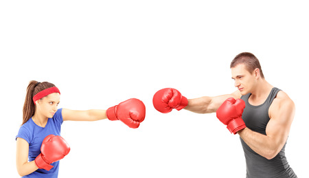 boxing match: Female and male boxers with boxing gloves during a match, isolated on white background