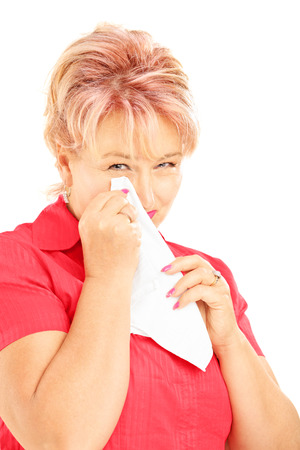 Sad mature woman wiping her eye from crying with tissue isolated on white background photo