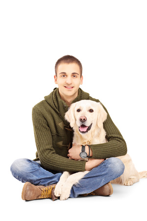 man dog: Smiling young man posing with a retriever dog isolated against white background Stock Photo
