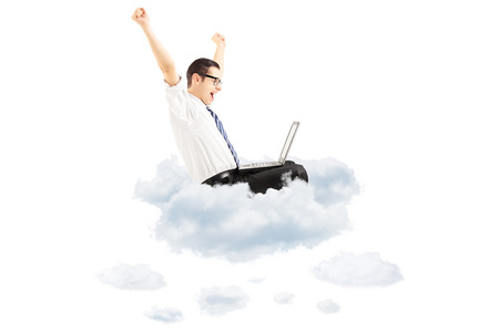 Happy young businessman flying on clouds with laptop and gesturing happiness isolated on white background Stock Photo - 22309830