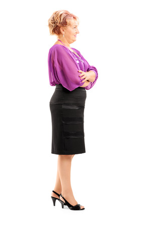 waiting in line: Full length portrait of a blond mature woman waiting in line isolated on white background Stock Photo