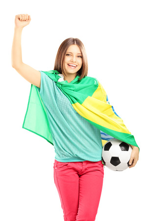 euphoric: Happy female fan with brazilian flag holding a soccer ball isolated on white background