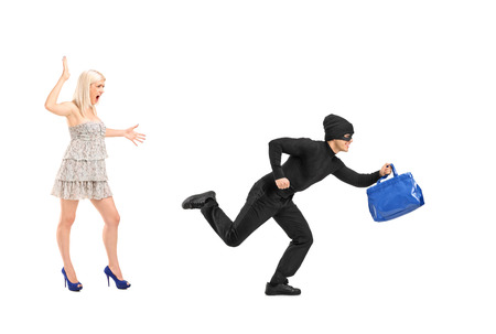 A nervous woman screaming after a thief stolen her purse bag isolated on white background photo
