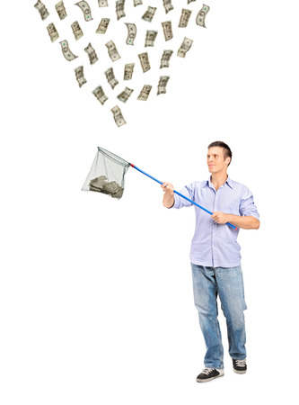 Full length portrait of a man collecting US dollars with a fishing net isolated on white background photo