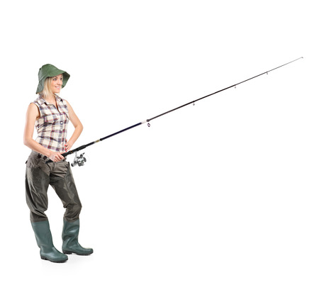 Full length portrait of a smiling fisherwoman holding a fishing pole isolated on white background Stock Photo