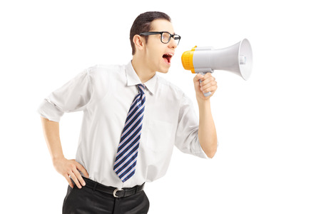 bawl: Angry businessman shouting via megaphone isolated on white background