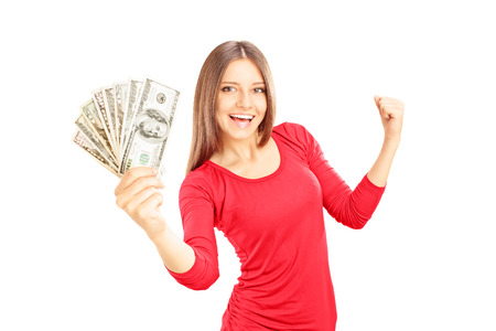 woman holding money: Happy female holding US dollars and gesturing happiness isolated on white background Stock Photo