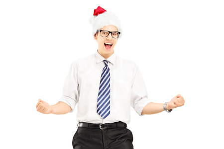 Happy male with santa hat gesturing happiness and looking at camera isolated on white background Stock Photo - 22428056