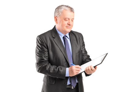 Mature businessman looking at documents isolated on white background photo