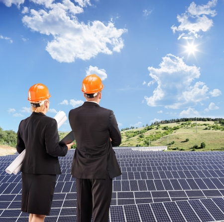 investor: Team of architects examining solar panels under sunny sky, Macedonia, shot with a tilt and shift lens Stock Photo