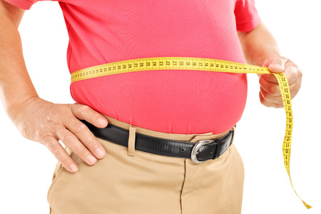 belly fat: Fat mature man measuring his belly with measurement tape, isolated on white background Stock Photo