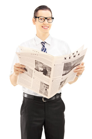 Young businessperson holding a newspaper and looking at camera isolated against white background photo