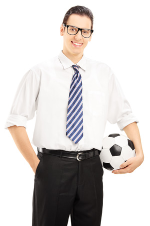 Confident male with tie holding a football isolated on white background photo