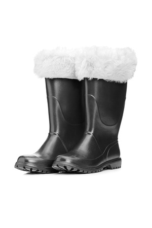 boots: Studio shot of a pair of santa boots isolated against white background Stock Photo